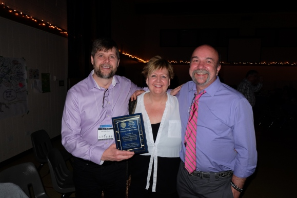 "our E.D., Ernie Baatz (left) accepted the award on behalf of our board, our colleagues, the teams we are part of and the famiies we support who have welcomed us with such open hearts.  ""You've challenged us, and we've been excited to meet the challenge.""  Shelley Nessman (centre), me (right)."